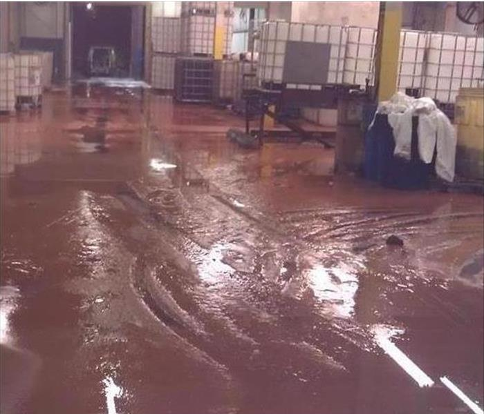 Storm Damage standing mud and water in warehouse